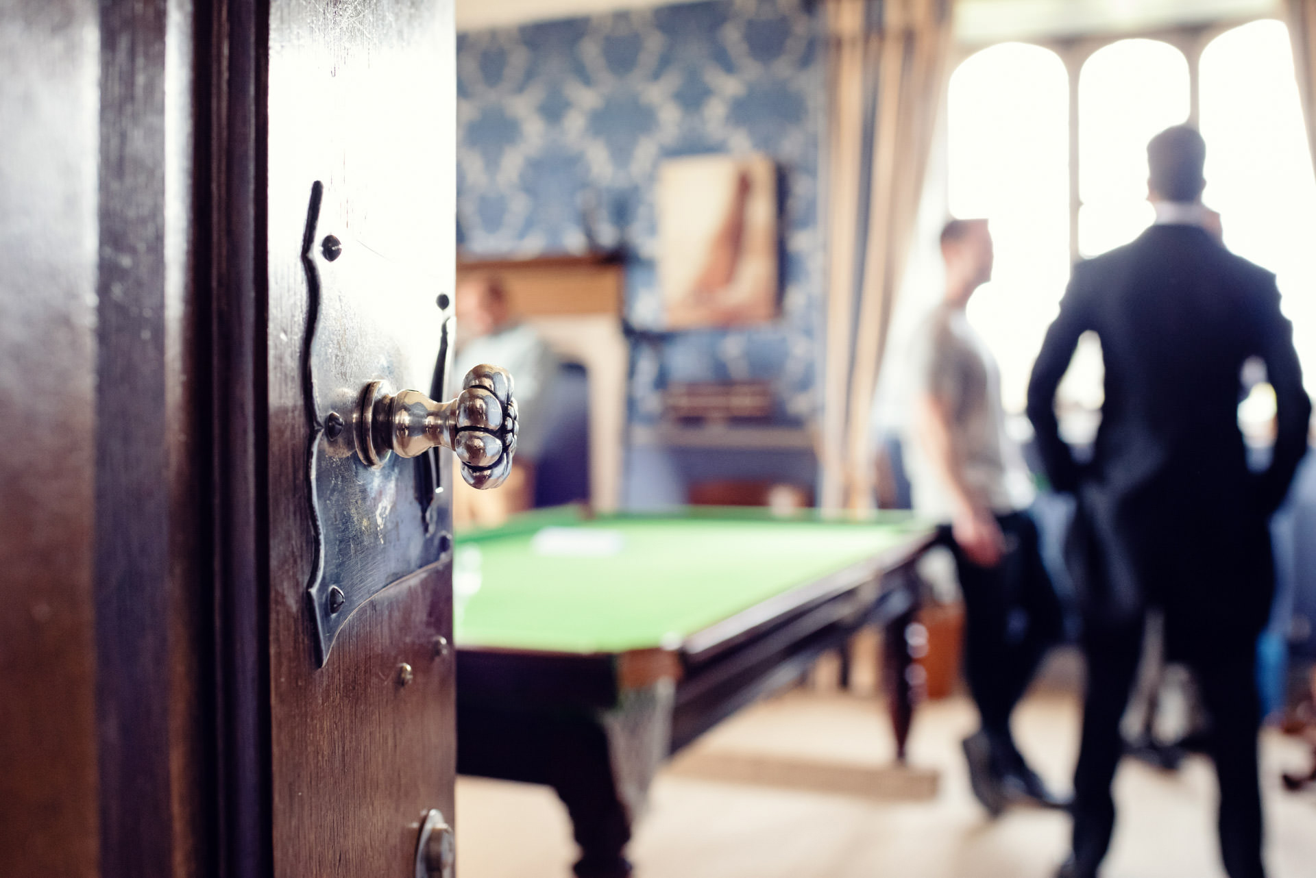 The groom, Best Man and Ushers in the Blue Room, relaxation room, with snooker table at Hengrave Hall, wedding venue in Suffolk, East Anglia