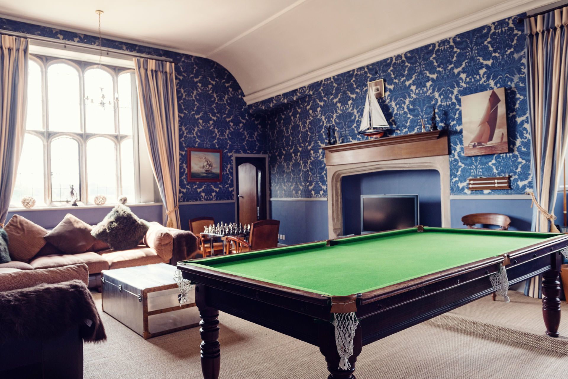 The Blue Room, relaxation room, with snooker table at Hengrave Hall, wedding venue in Suffolk, East Anglia