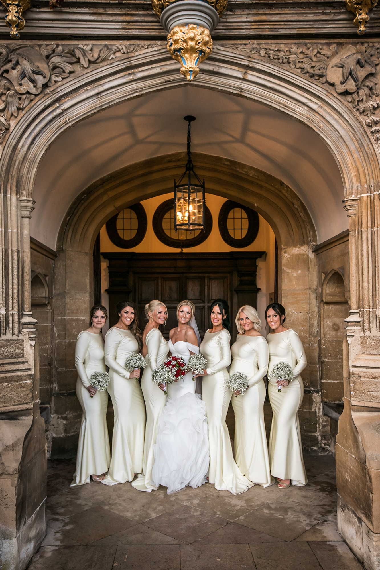 The Bride and Bridesmaids posing in the entrance hall of Hengrave Hall