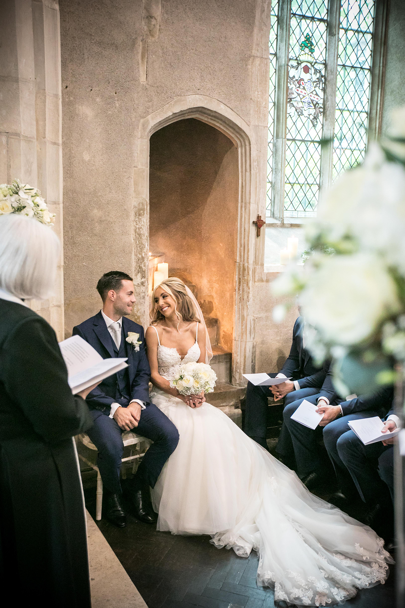 Close up of a couple getting married in the Church of St John Lateran, on the grounds of Hengrave Hall