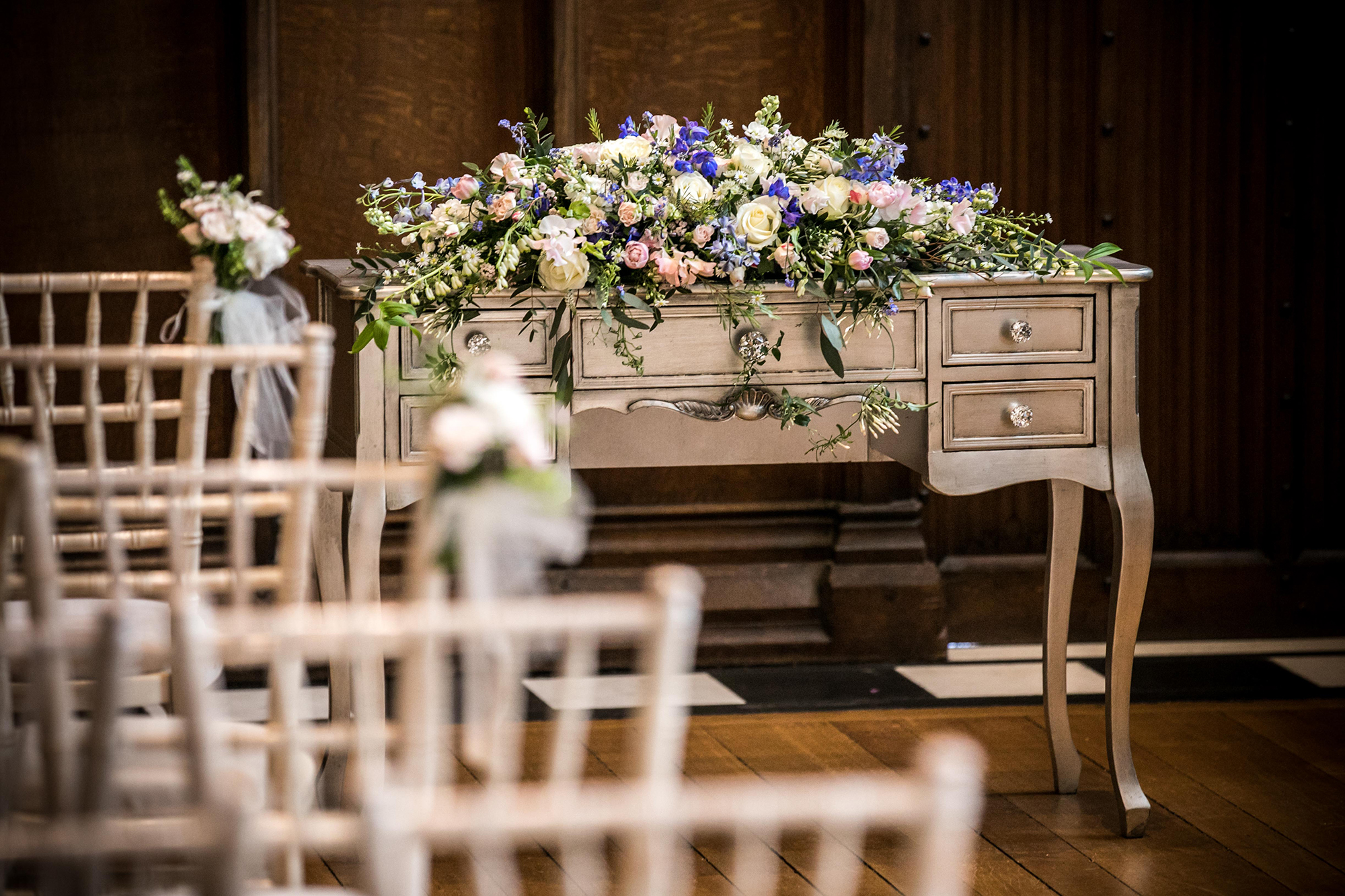 Wedding ceremony room with furniture and flowers at Hengrave Hall