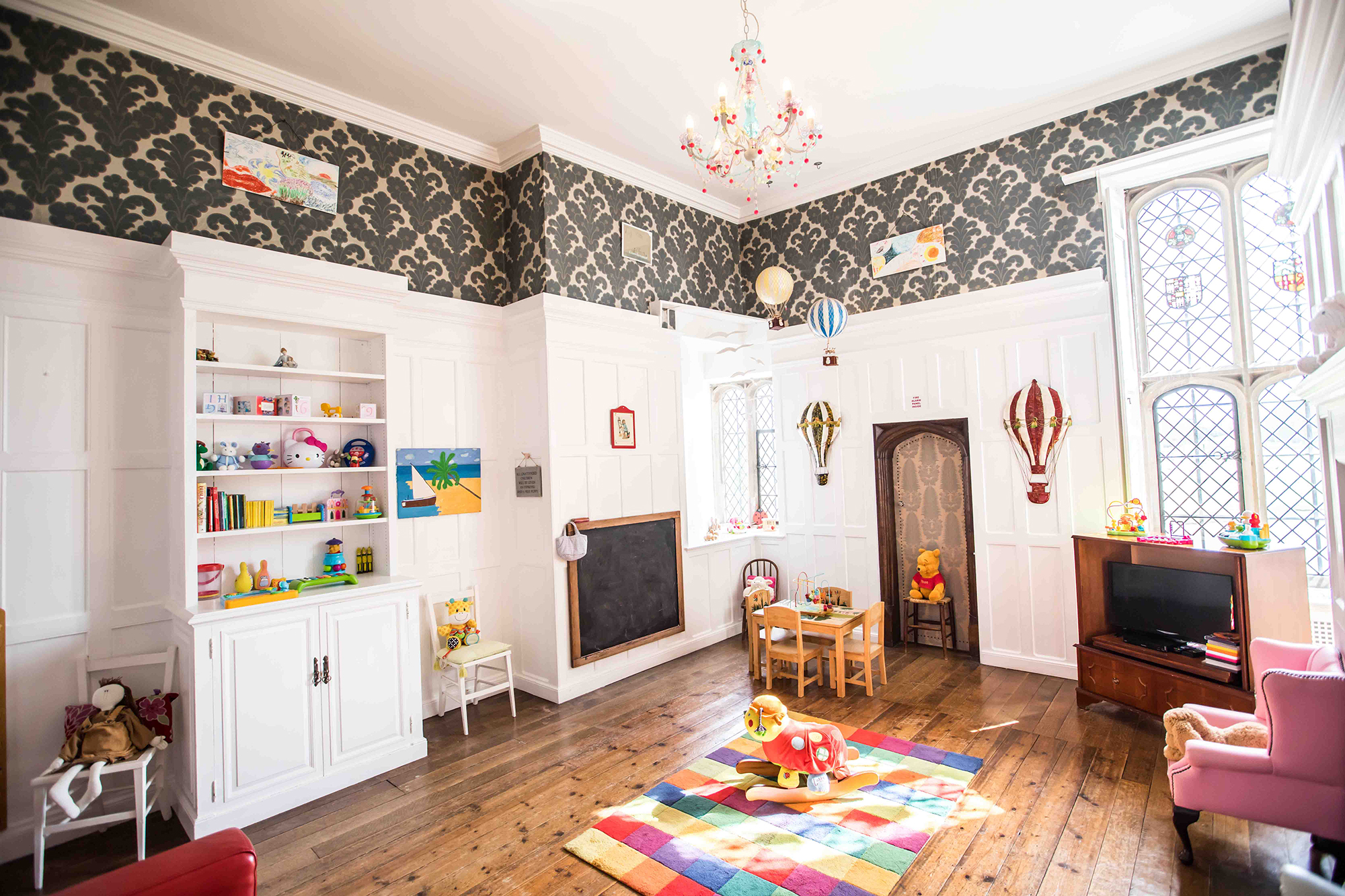 Colourful and inviting childcare playroom, ready for guests children, during wedding functions at Hengrave Hall