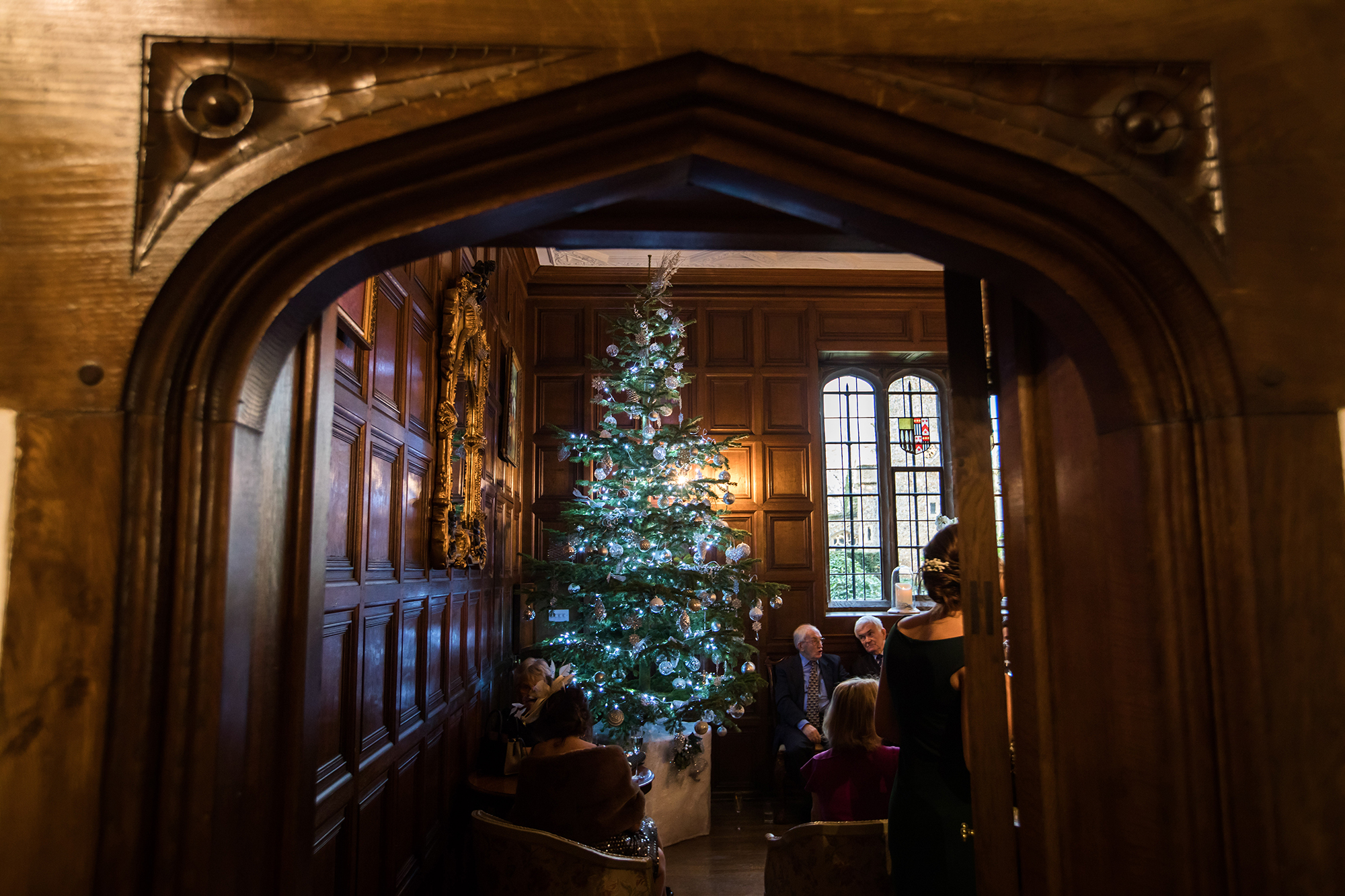 Christmas tree and guests in the stunning Tudor mansion, Hengrave Hall