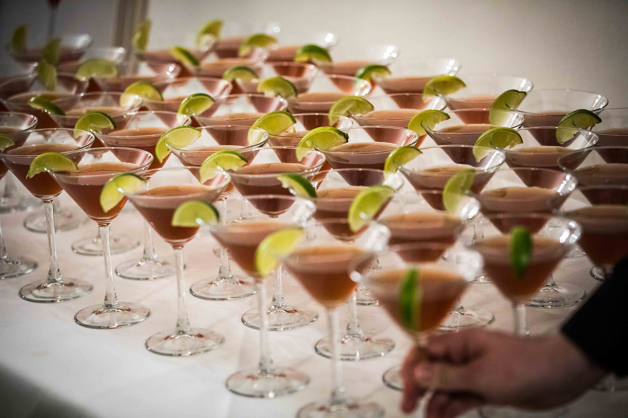 A table full of cocktails for wedding reception guests at Hengrave hall