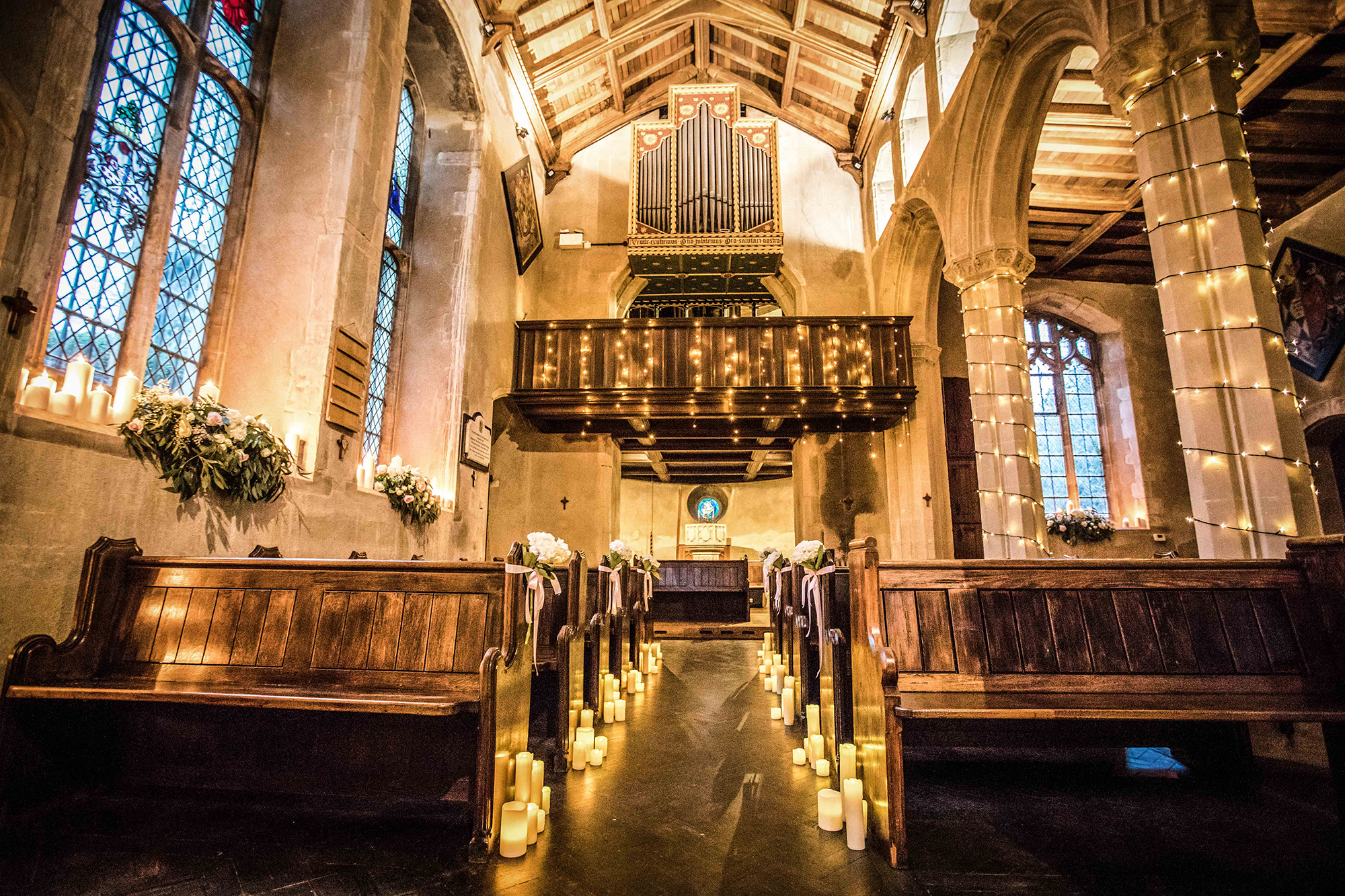 Inside of the Church of St John Latera in candlelight on the grounds of Hengrave Hall