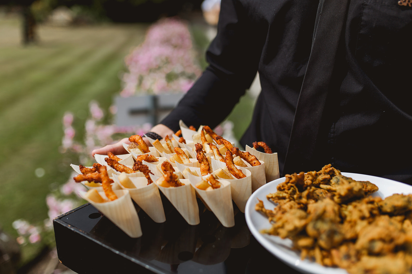 Wedding canapés being served in the grounds at Hengrave Hall