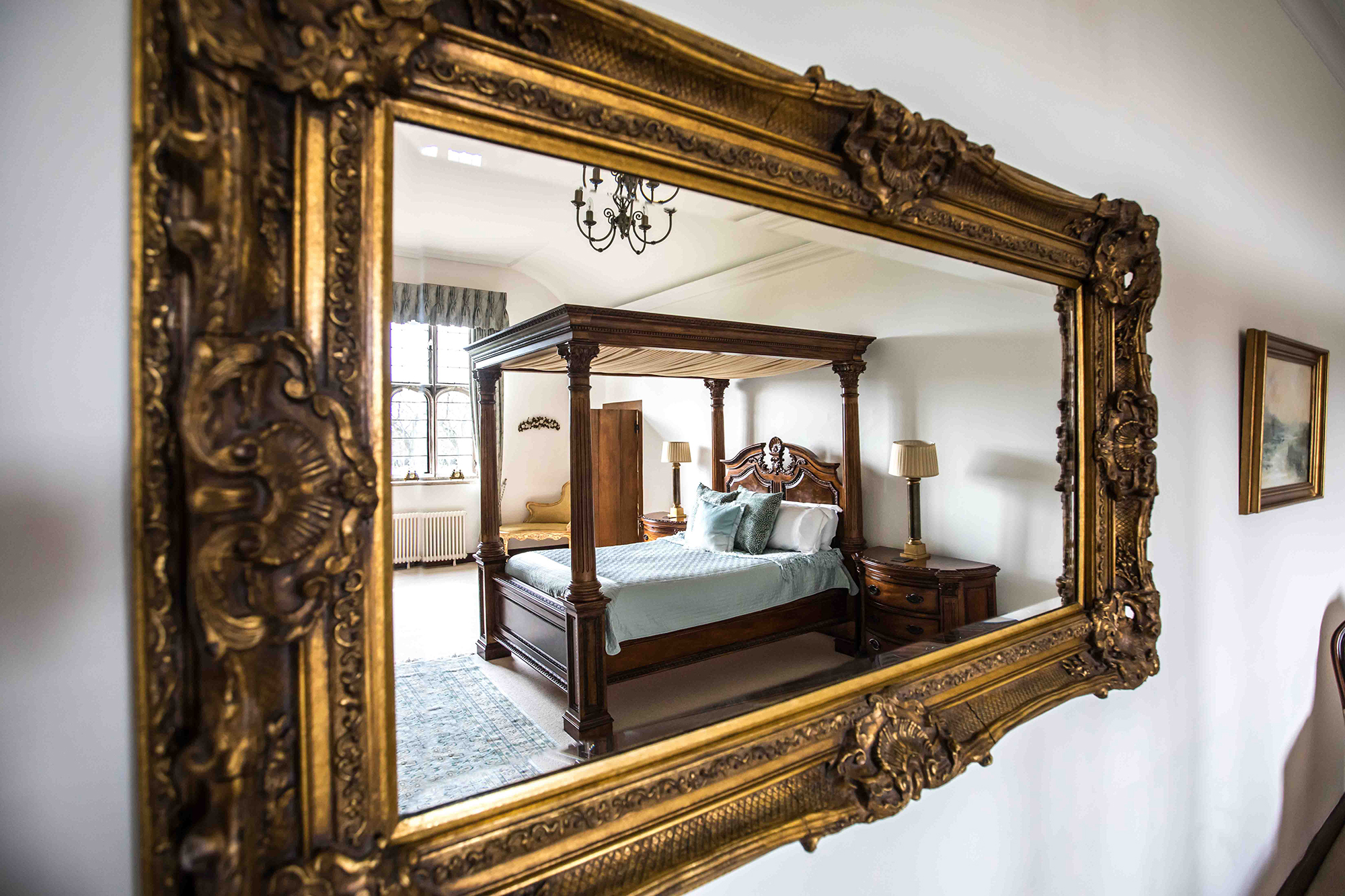 Bed and Bedroom in a mirror at Hengrave Hall